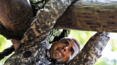 U.S. Army Staff Sgt. Victor Marquez-Rodriguez Sr., Fort Sill, Okla., drill sergeant, climbs across a log to get to a waiting rope that he can use to lower himself down on the confidence course at Fort Eustis, Va., June 27, 2012, as part of the annual Drill Sergeant of the Year competition, hosted by Initial Military Training, U.S. Army Training and Doctrine Command. The yearly competition is designed by the previous year's winner and is meant to challenge each drill sergeant, both physically and mentally.