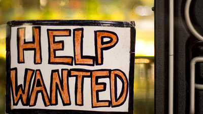 Photo of help wanted sign for job seekers