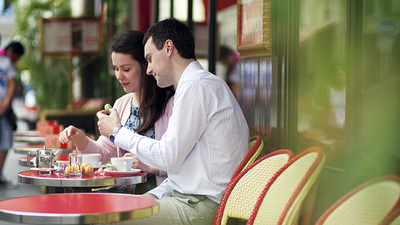Couple eating at cafe