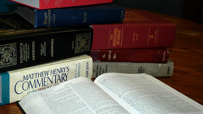 A photo of a Bible, the place to look for to finding out what God's name is.