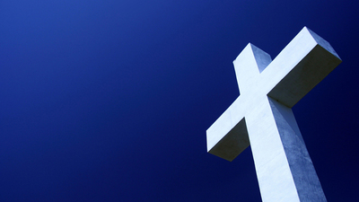A picture of a cross, a symbol of Christianity that people wear.