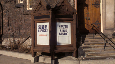 Photo of a church's advertisement of Sunday worship, but is Sunday God's day or is it Saturday?