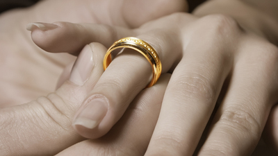Bright gold ring on hand