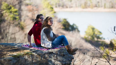 Students of Herbert W. Armstrong College enjoy their view of a lake at Robber's Cave.