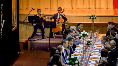 EZEKIEL AND SETH MALONE PLAY CLASSICAL MUSIC WHILE FACULTY, STUDENTS AND FAMILIES CONVERSE DURING GRADUATION BRUNCH