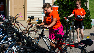 A member of dorm 1G puts up her bike after a run on the cycling long course