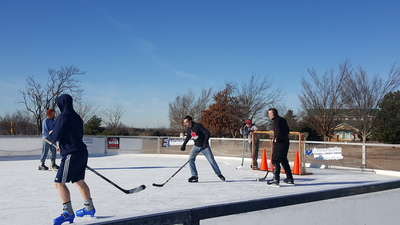 Philadelphia Church of God members play hockey in Edmond during the ministerial conference