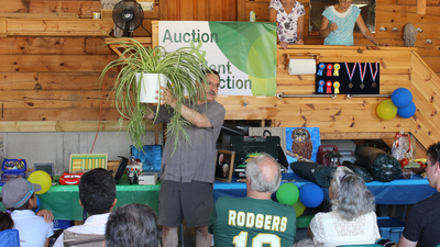 Regional Director Fred Dattolo takes bids during the live auction.