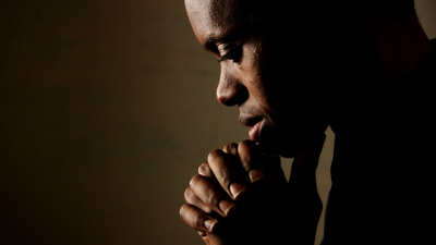 Young man praying.