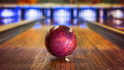 Bowling ball on bowling alley - Focus on ball
