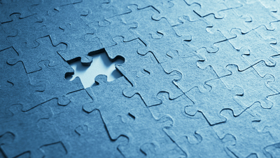 Jigsaw puzzle close up. Blue tone for the mood.