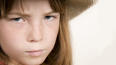 Upset Young Girl With Hat On.