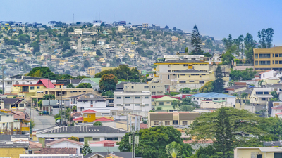 Elegant neighborhood and favela hill view of Guayaquil city, Ecuador 16x9