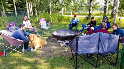ACT CAN campout brethren sitting by campfire 16x9