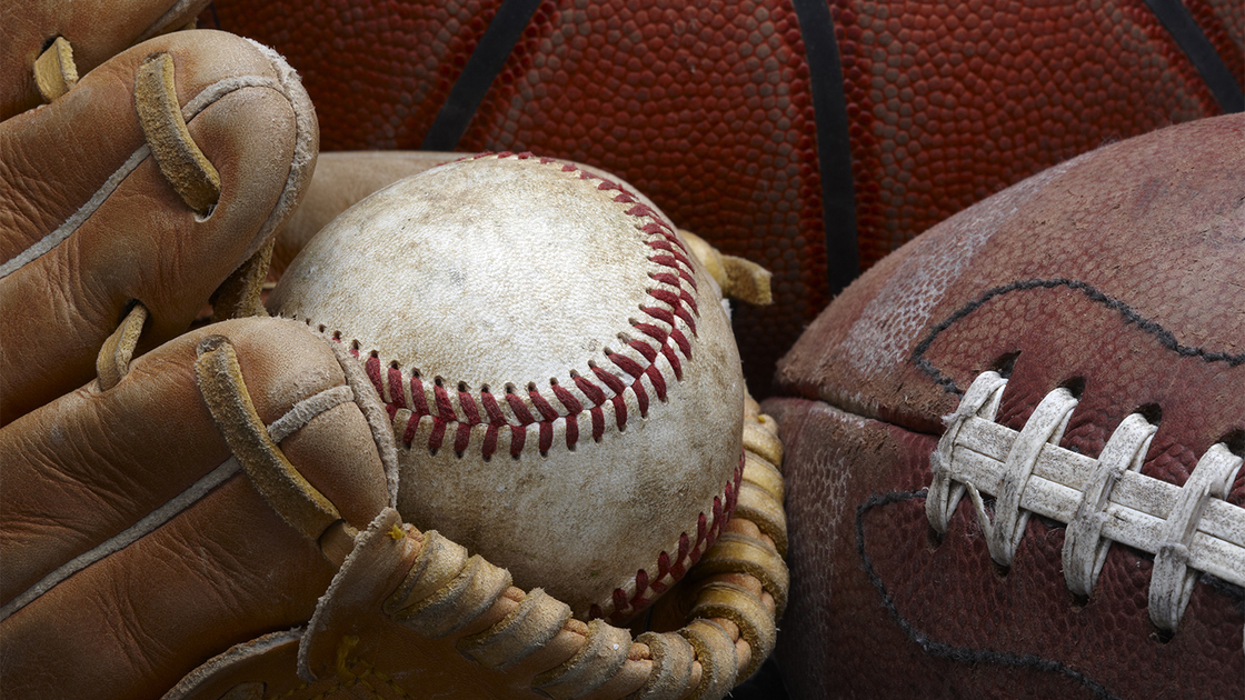 close up shot of well worn baseball in baseball glove, football and basketball So you want to go to PYC 16x9