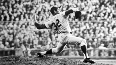 4/24/1962-Chicago, IL: Los Angeles Dodger Sandy Koufax shows winning form as he throws during a game with the Chicago Cubs.  Koufax struck out 18 Chicago Cubs setting a National League daytime strikeout record and tying his own overall National League strikeout mark.  The Dodgers won, 10-2.