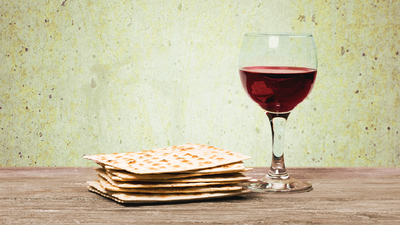 Pesach. Passover background. wine and matzoh (jewish passover bread)  over wooden background. vintage effect process.