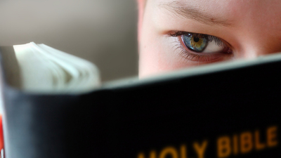 Boy Reading the holy bible