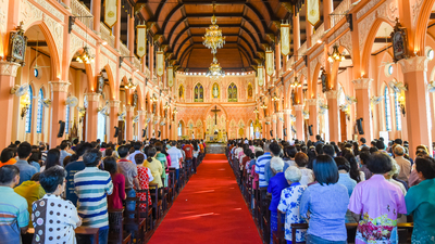 Chantaburi, Thailand - January 1, 2016: Group of pastors doing religion ceremony while Chistian people standing to attend religion ceremony in occasion of new year festival in beautiful church in Chantaburi, Thailand