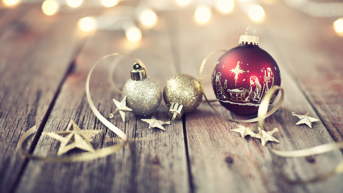 Christmas holiday nativity bauble and rustic decorations on an old wood background with defocused lights