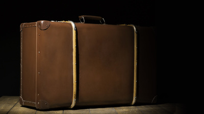 old vintage suitcase on wooden floor