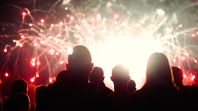Crowd watching fireworks and celebrating at night