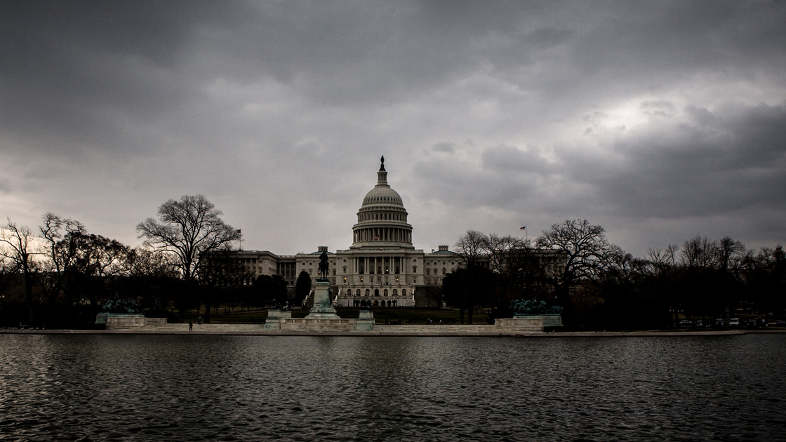 US Capitol Building under dark, gloomy skies. US Capitol Building in Washington D.C.