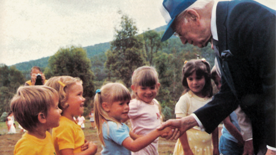 Herbert W. Armstrong meets children at an Australian youth camp.